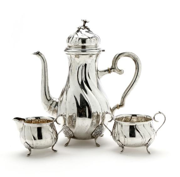 Silver coffee pot and sugar and cream set