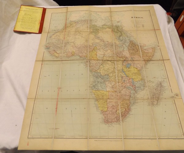 E STANFORD: MAP OF AFRICA, coloured map circa 1901, folding backed onto linen, original cloth worn