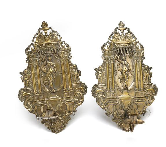 A pair of 18th century régence partly silvered brass sconces