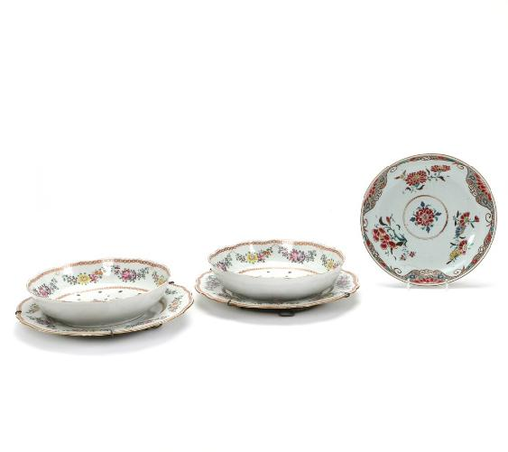 Two Chinese porcelain strainer bowls with matching dishes and dish