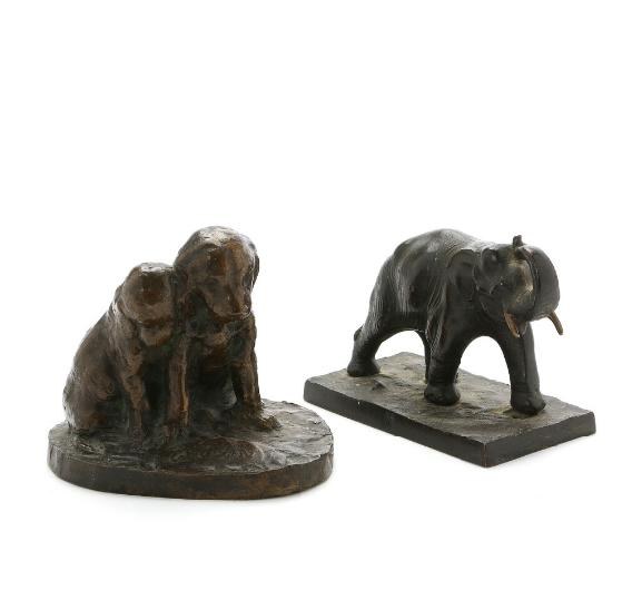 Two 20th century patinated bronze figures of respectively an elephant and two puppies
