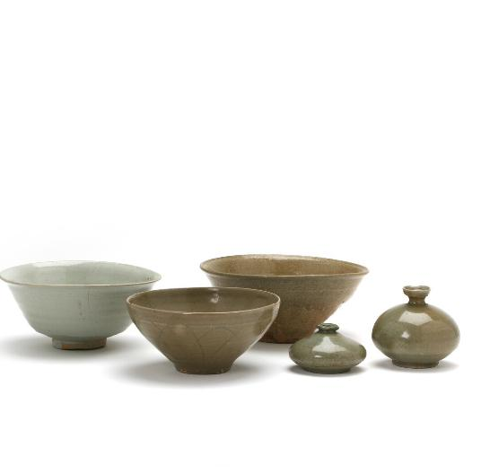 Two Corean stoneware oil bottles and three bowls with greenish celadon glaze, one bowl with lotus incised on the outside