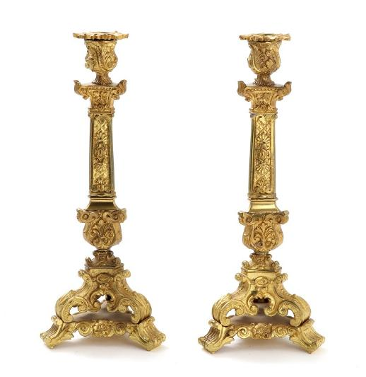 A pair of 19th century gilt bronze candlesticks, richly cast with rocailles
