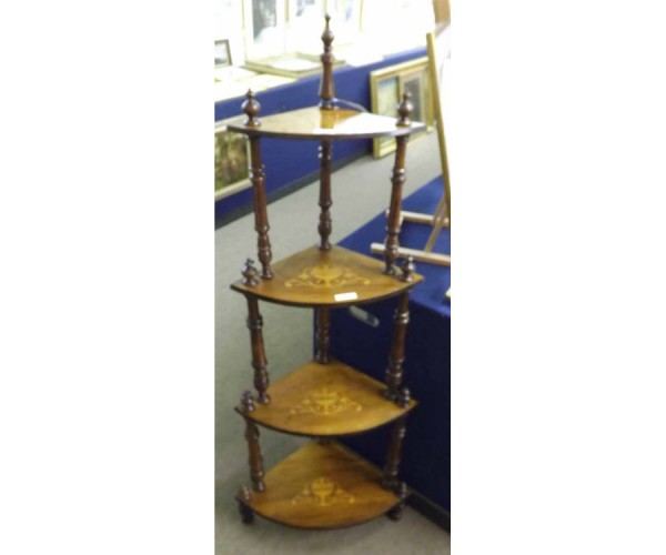 Victorian bow fronted four tier whatnot, each shelf inlaid with a central marquetry panel and raised on ring turned supports