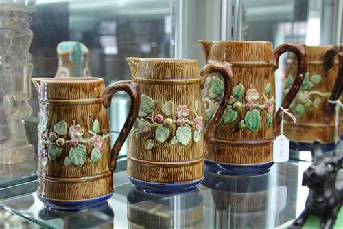 English Antique Majolica Set of Three Graduated Jugs all having a timber type finish