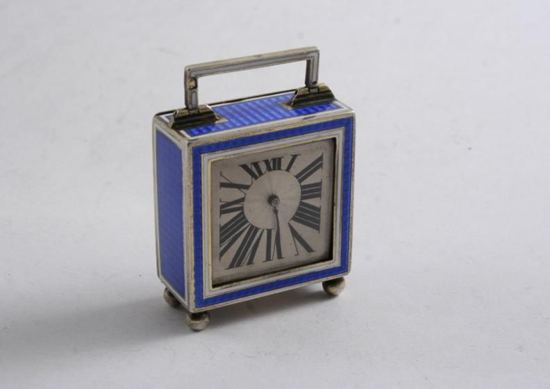 A FRENCH ART DECO BOUDOIR OR MINIATURE CARRIAGE TIMEPIECE