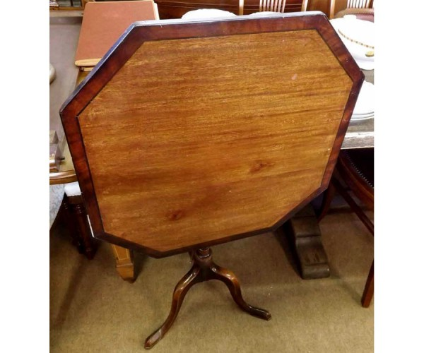 19th century mahogany octagonal top wine table, raised on a turned stem and tripod base