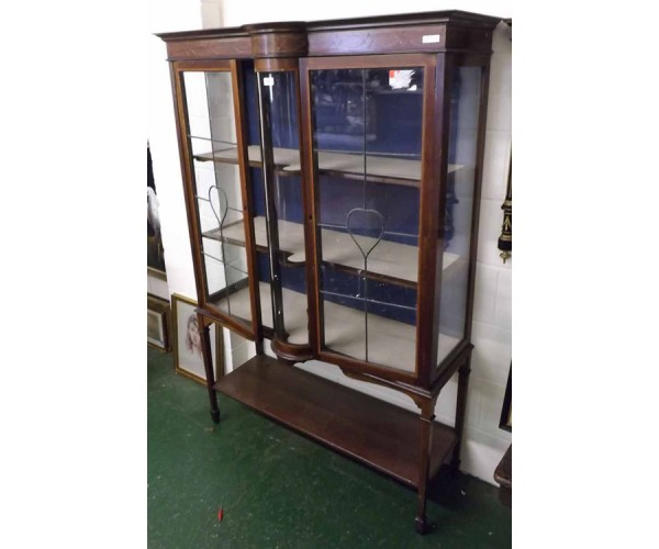 Edwardian mahogany and inlaid two door china display cabinet, glazed doors opening to a two shelf interior, raised on tapering l
