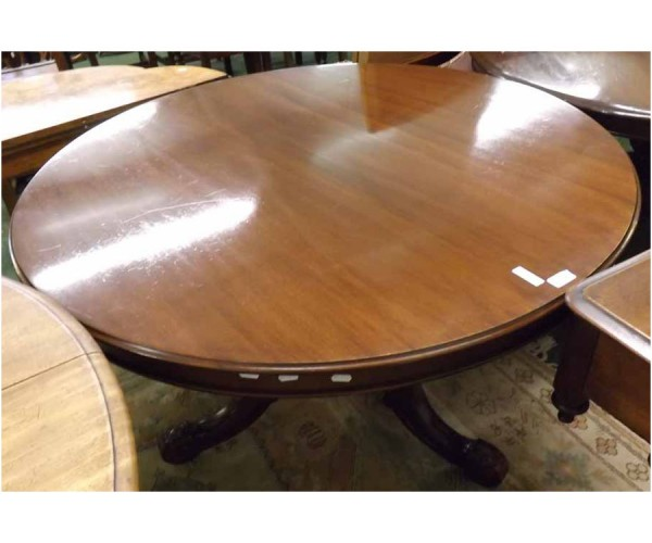 Victorian mahogany circular breakfast or dining table, raised on a turned column and tripod base with castors