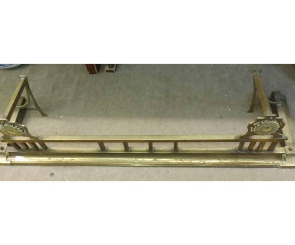 19th century brass fire fender with railed top and flower decoration