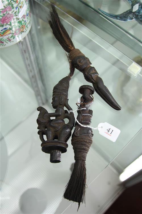 THREE MAGIC CHARMS Buffalo horn, hair, feather, rattan - black patina