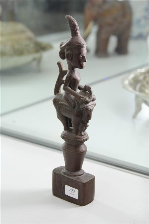 STOPPER - Wood - brown patina - figure seated on a Singha with the stopper attached to a contemporary base