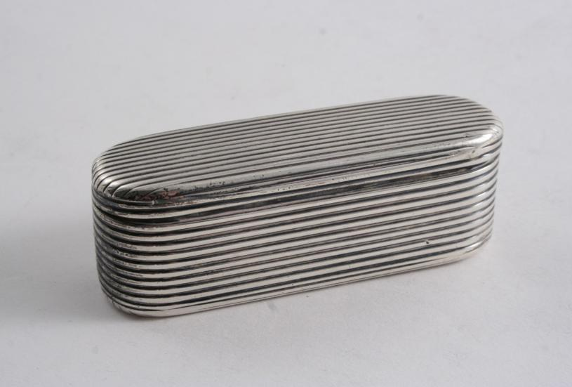 A GEORGE III REEDED OBLONG SNUFF BOX