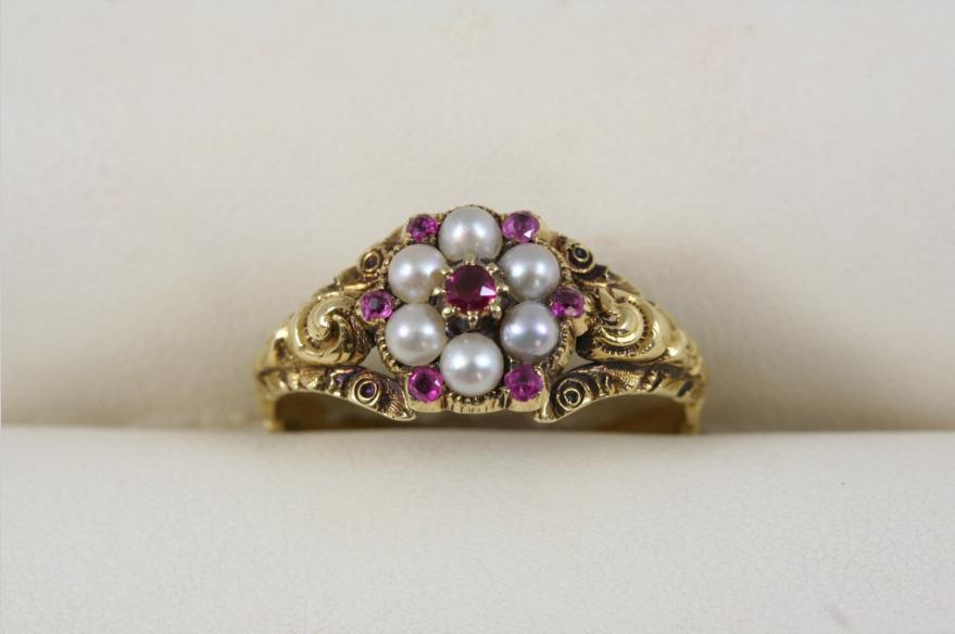 A VICTORIAN RUBY AND PEARL FLOWER HEAD RING