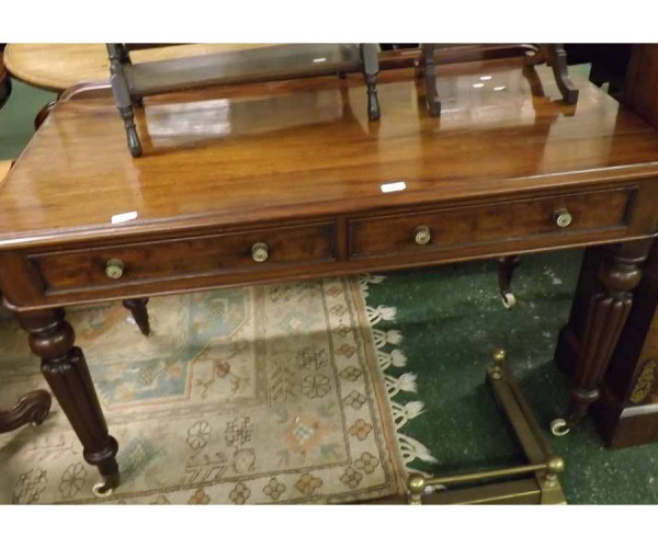 Victorian mahogany two drawer side table, raised on fluted legs and brass and ceramic castors