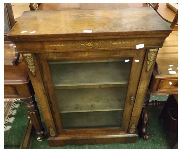 Victorian walnut veneered pier cabinet, with single glazed door, raised on a plinth base