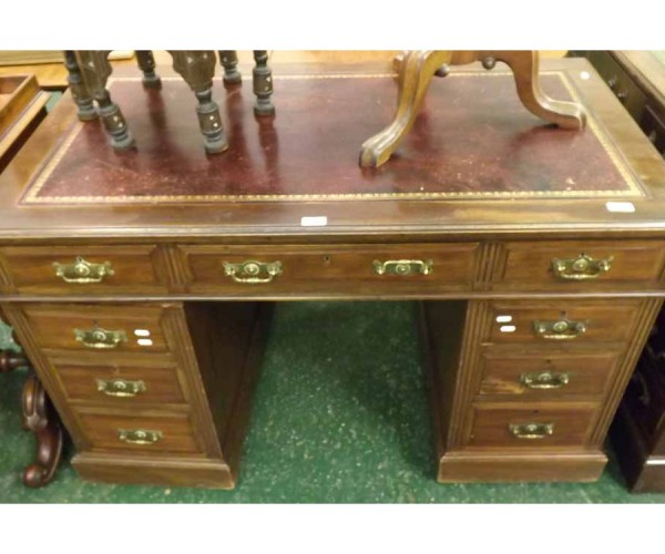 Late 19th century mahogany twin pedestal desk, red leather inset top, body with one long and eight short drawers