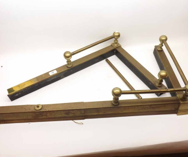 Large late 19th or early 20th century extending brass fire fender, with railed detail
