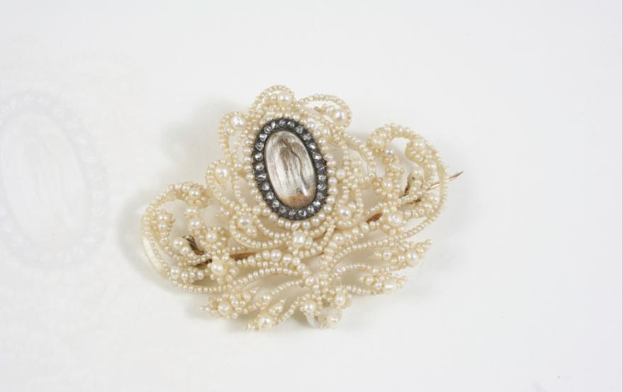 A VICTORIAN SEED PEARL AND DIAMOND BROOCH