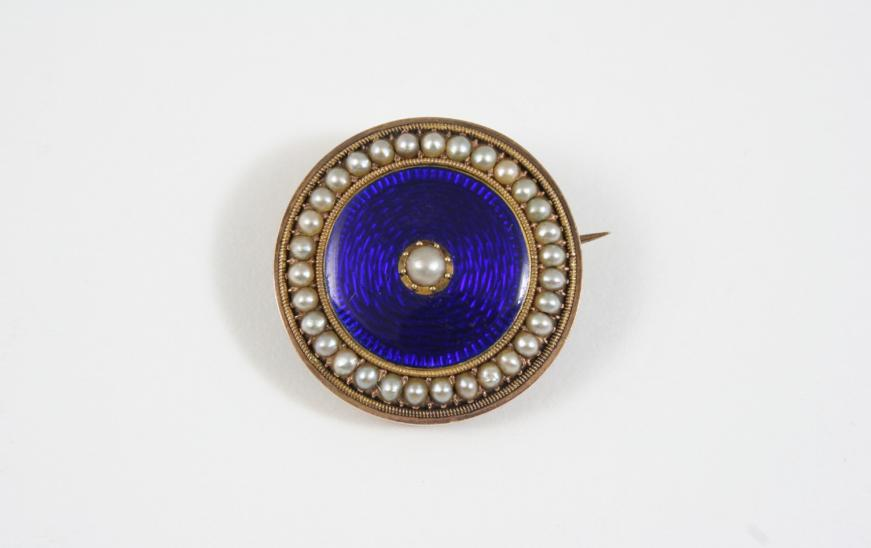 A VICTORIAN ENAMEL AND PEARL BROOCH