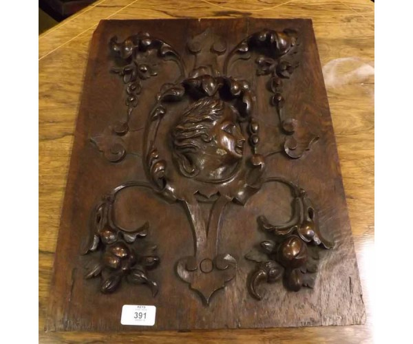19th century continental wall plaque, decorated with carved central face and floral swags