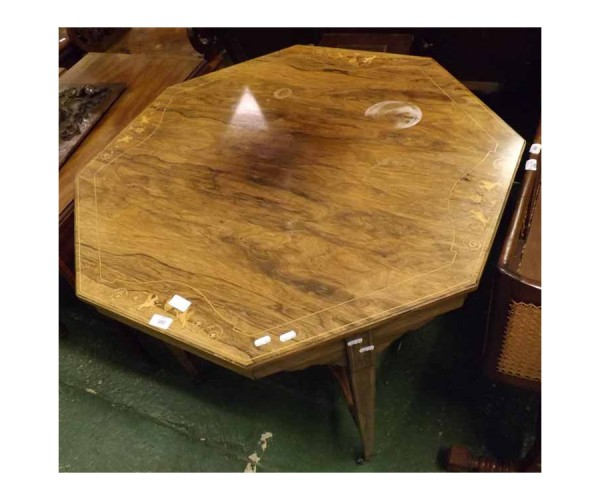 Late 19th century rosewood octagonal centre table, decorated with inlaid detail, raised on tapering with cross stretcher and cas
