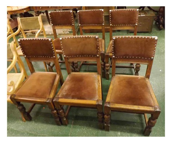Set of six 20th century oak dining chairs, with upholstered seats and backs, raised on turned front legs