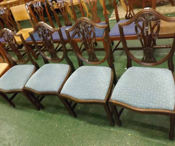 Set of four 20th century mahogany shield back dining chairs, with blue upholstered push out seats