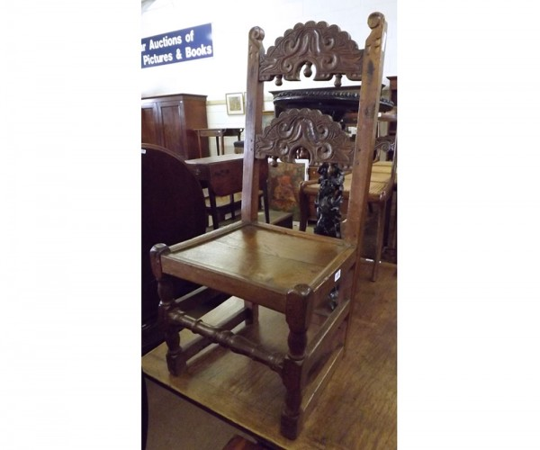 Oak hall chair, carved shaped rail back over a solid seat, 18th/19th century