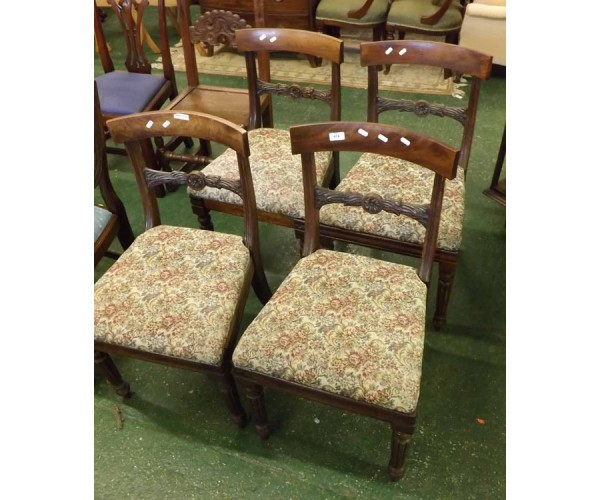 Set of four 19th century mahogany bar back dining chairs, the floral upholstered seats raised on fluted front legs