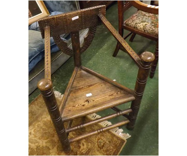 Unusual late 19th century oak and pine seated turners chair, with carved back