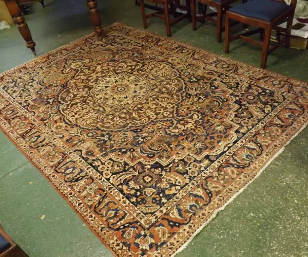 20th century Iranian Isfahan floor rug, typically decorated with stylised foliage and geometric detail, approx 10ft x 7ftry oak