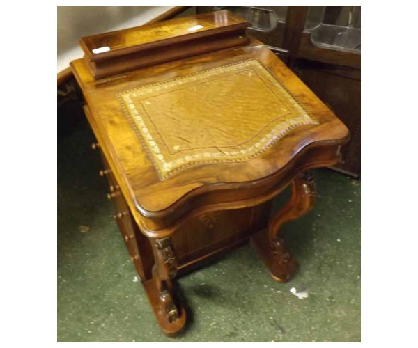 Walnut veneered davenport, of typical form, the sloped front opening to an interior with four small drawers, the base with four