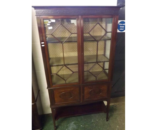 Edwardian mahogany china display cabinet, the astragal glazed top section over two cupboard doors and shelf base