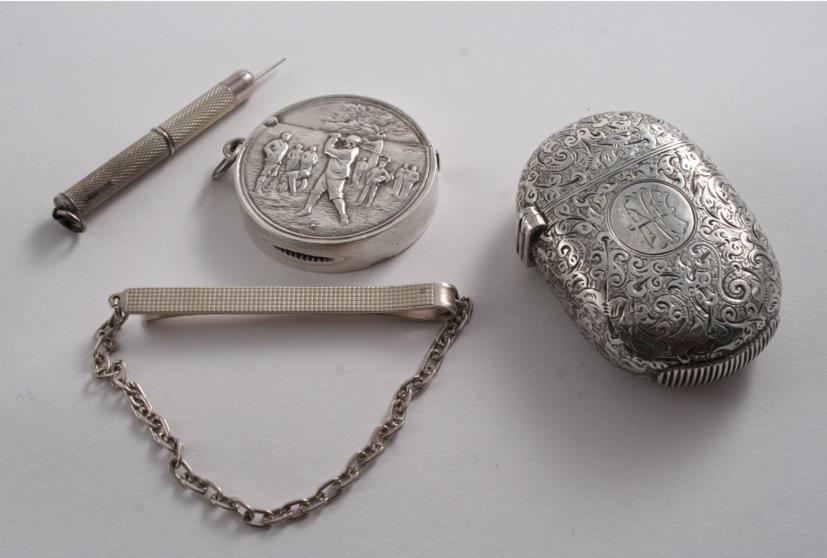 A Victorian engraved oval vesta case