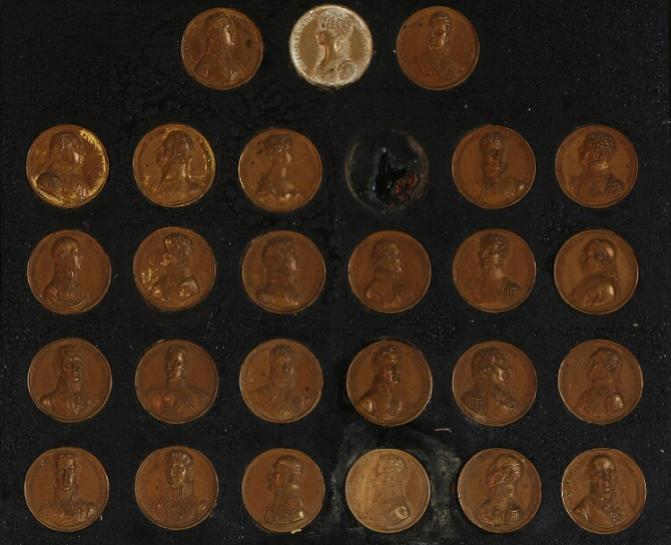 Collection of 26 medailles mounted in frame