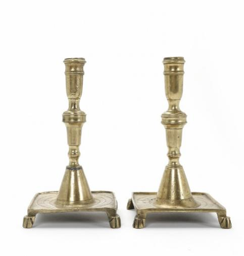 A pair of Dutch brass candlesticks