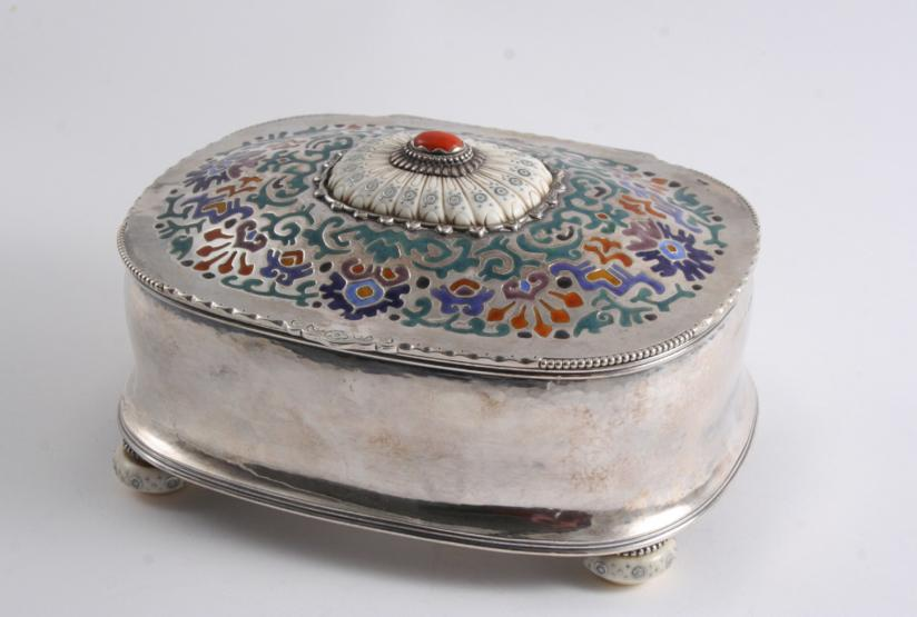 An early 20th century Norwegian mounted ivory & enamelled casket of rounded oblong form with a hammered finish and inalid ivory