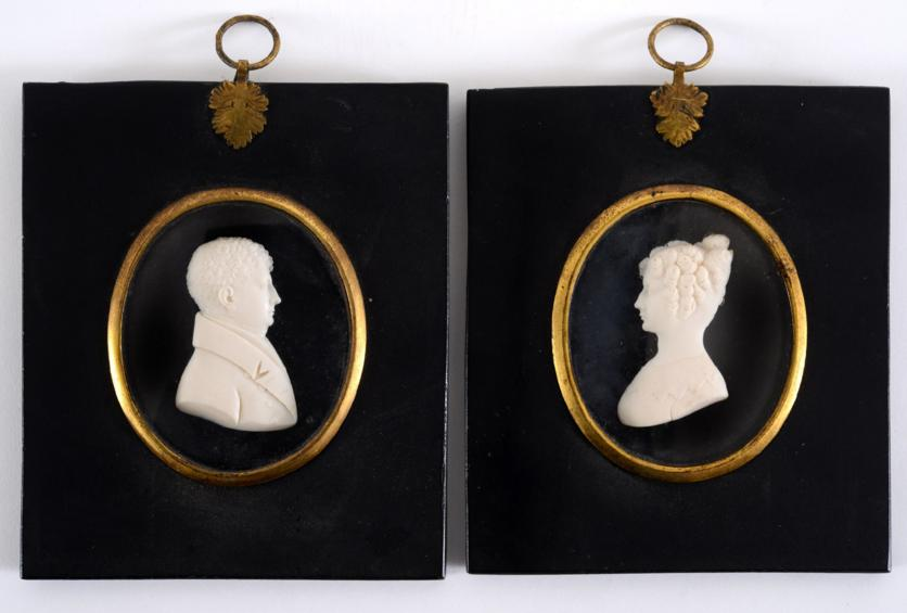 A PAIR OF IVORY MINIATURE PORTRAITS