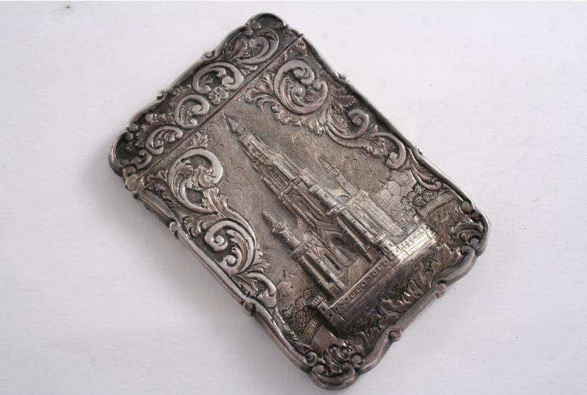 "A VICTORIAN EMBOSSED ""CASTLE TOP"" CARD CASE"