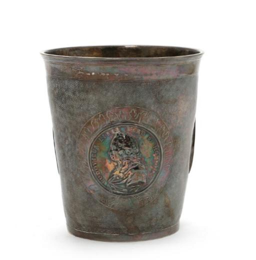 Pricked silver beaker insertet with coins