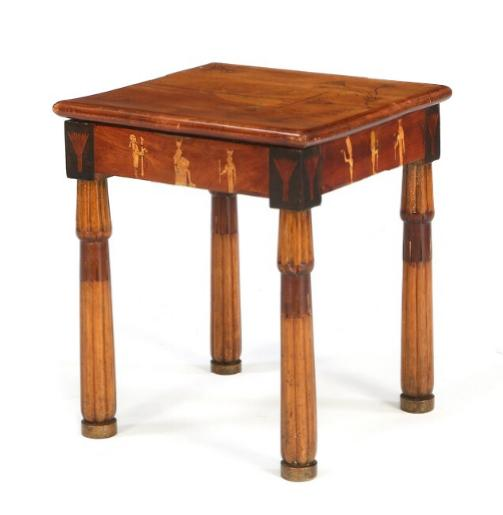A Danish mahogany stool with inlays in the shape of Egyptian figures