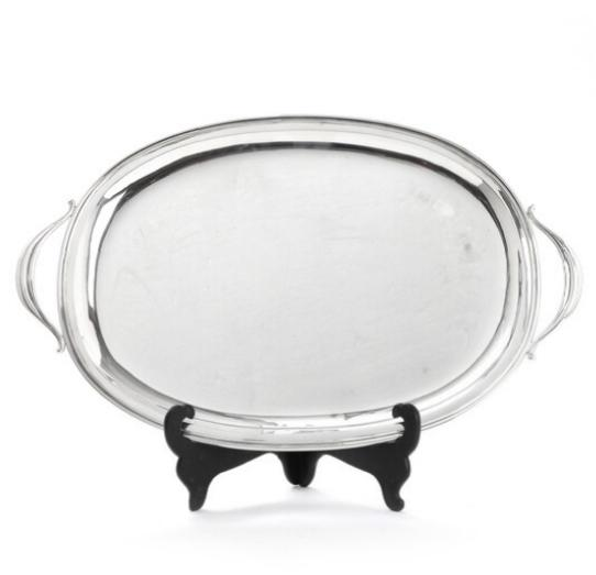 An oval sterling silver serving tray