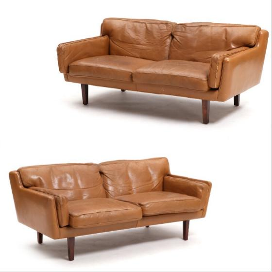 A pair of two-seated sofas with rosewood legs