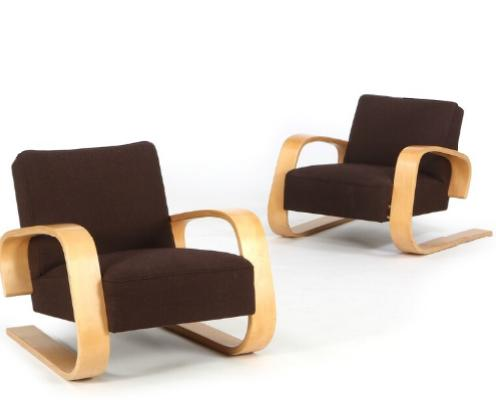 """""""Tank"""". A pair of easy chairs of moulded beech. Seat and back upholstered with brown wool"""
