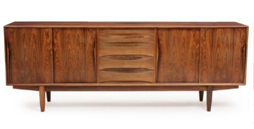 A rosewood sideboard, front with four sliding doors and five drawers with curved handles