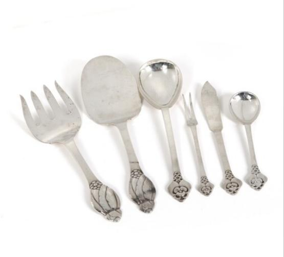"""""""No. 6"""" and """"No. 2"""". Hammered silver cutlery and serving pieces."""