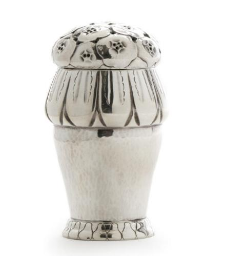 A sterling silver sugar sifter with stylized ornamentation