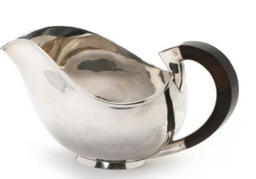 A sterling silver sauce boat with guaiacum wood handle