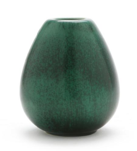 "A circular ""drop""-shaped stoneware vase decorated with green glaze with black/brown elements"